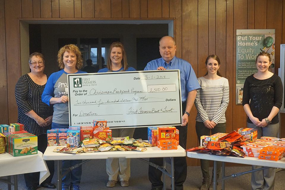 Chrisman branch makes donation to local Backpack Program.
