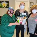Oakland Branch delivers gift basket to local Clinic
